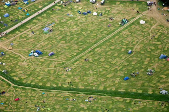 CLEAN-UP: Aerial views of Worthy Farm, home of the Glastonbury Festival, as the clean-up operation got underway on July 1. PICTURE: SWNS