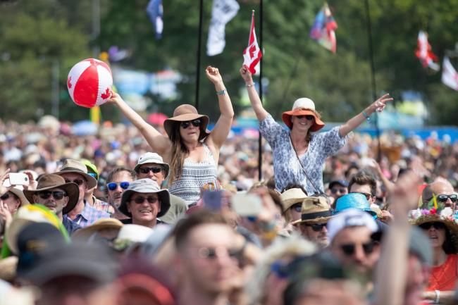 Members of the crowd watch Sheryl Crow on the third day of the Glastonbury Festival at Worthy Farm in Somerset. PRESS ASSOCIATION Photo. Picture date: Friday June 28, 2019. See PA story SHOWBIZ Glastonbury. Photo credit should read: Aaron Chown/PA Wire.