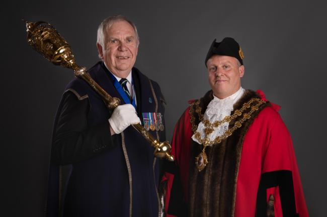 SWORN IN: Clive Sanders as mace bearer and Cllr Jason Baker as mayor