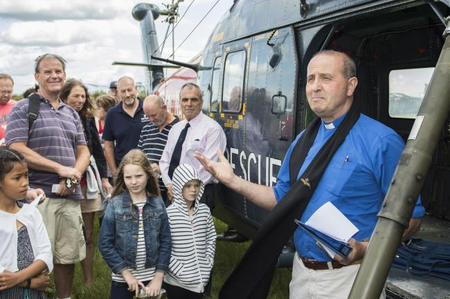 Former Fleet Air Arm pilot Albie Fox (pink shirt) and Royal Navy Diver 'Smiler' Grinney reuinited with Westland Wessex HU5 XT761 at Historic Helicopters, Chard, Somerset, 18 August 2019. On 14 August 1979, both men were involved in the rescue of y