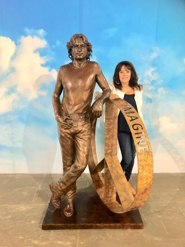 APPEAL: Sculptor Laura Lian with her John Lennon Peace Statue