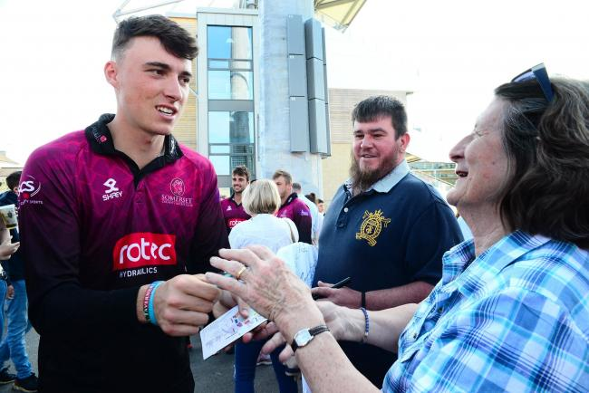 RISING STAR: Tom Banton signs an autograph at Somerset's One-Day Cup celebration event last year