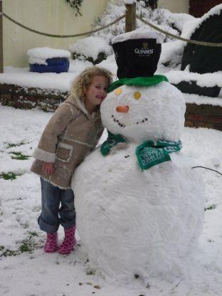 Lauren Kelly with her snowman in Yeovil. Photo: Mark Kelly