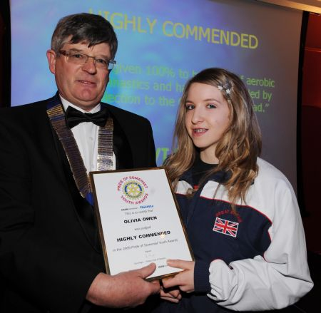 Olivia collects her award from Don Heys, president of Taunton Rotary Club