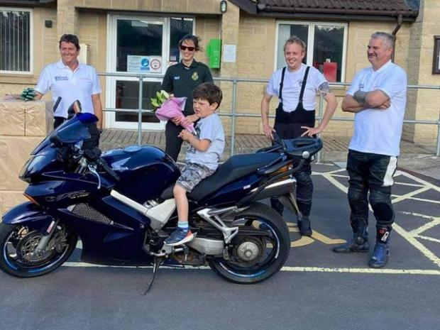 Yeovil Express: Dave and Joe presenting Tors Bush and her son Seth with some flowers as a thank you for all her help in coordinating the ride