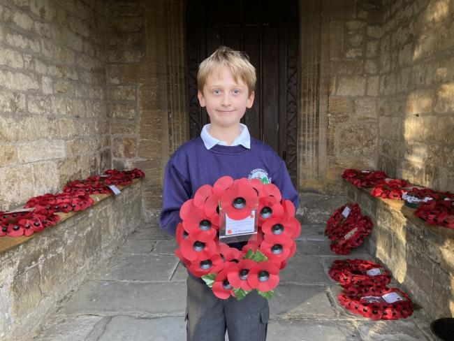 A pupil laying a wreath at The Minster