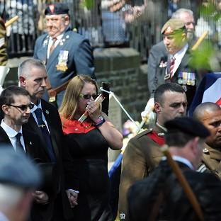 Private Christopher Kershaw's father Brian and stepmother Sharon Wood follow his coffin as it is carried into Holy Trinity Church, Idle, Bradford