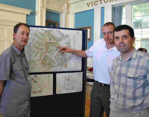 MORRISH Builders' sales and marketing manager Tim Bishop (centre) with Tim Orchard (left) of Chard, who went to the exhibition at the Guildhall, and South Somerset District Council's area development manager Andrew Gillespie.