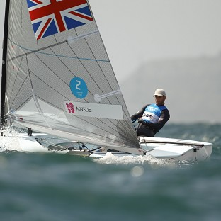 Ben Ainslie, pictured, is just two points behind Jonas Hogh-Christensen in the overall fleet standings