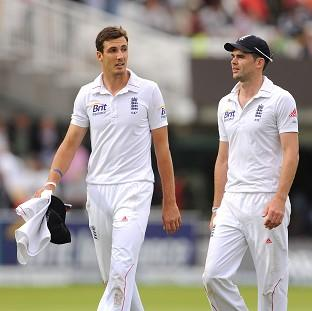 Steven Finn, left, and James Anderson, right, claimed three wickets apiece on the first day