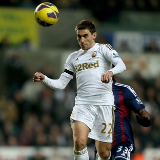 Angel Rangel, pictured, insisted Michael Laudrup had made a 'big difference' to Swansea
