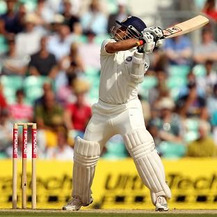 Sachin Tendulkar struck two late sixes to help India over the line