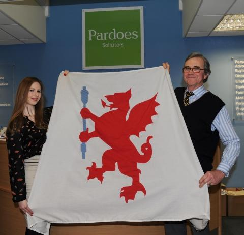 Jenny Evans and Nigel Muers-Raby, from Pardoes, show off the flag they fly in the name of Somerset but are ready to replace it with the winning design.
