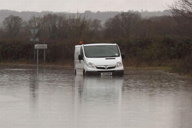 Yeovil Express: A VAN gets stuck in flood water at Broadway during the worst of the flooding. PHOTO: Ian Goddard