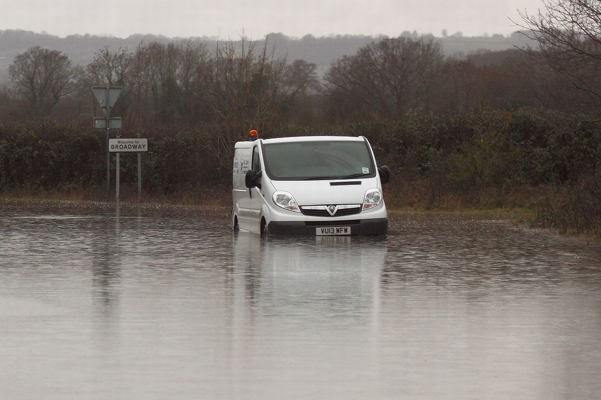 A VAN gets stuck in flood water at Broadway during the worst of the flooding. PHOTO: Ian Goddard