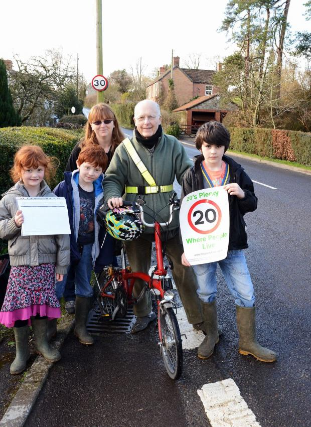 Yeovil Express: CAROLINE Hooper and her children, Emily, six , Tom, eight, and William, seven, with Cllr Andrew Turpin.