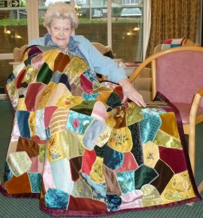 FREDA Cave with her completed quilt.