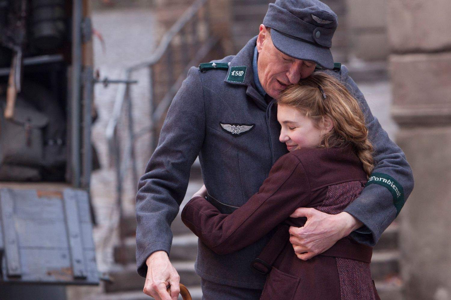 LIESEL (Sophie Nélisse) embraces her foster father Hans (Geoffrey Rush) in The Book Thief.