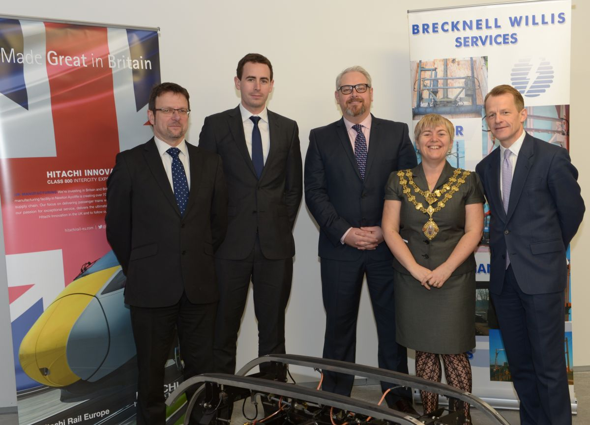 BRECKNELL Willis managing director Richard Whitefield with Ben Snodin and Jamie Foster from Hitachi, David Laws MP, and the Mayor o