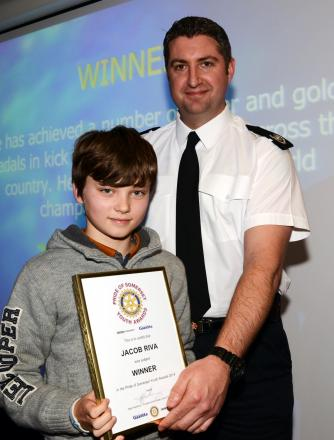 JACOB Riva receives his award from Gavin Ellis, of sponsors Devon and Somerset Fire and Rescue Service.
