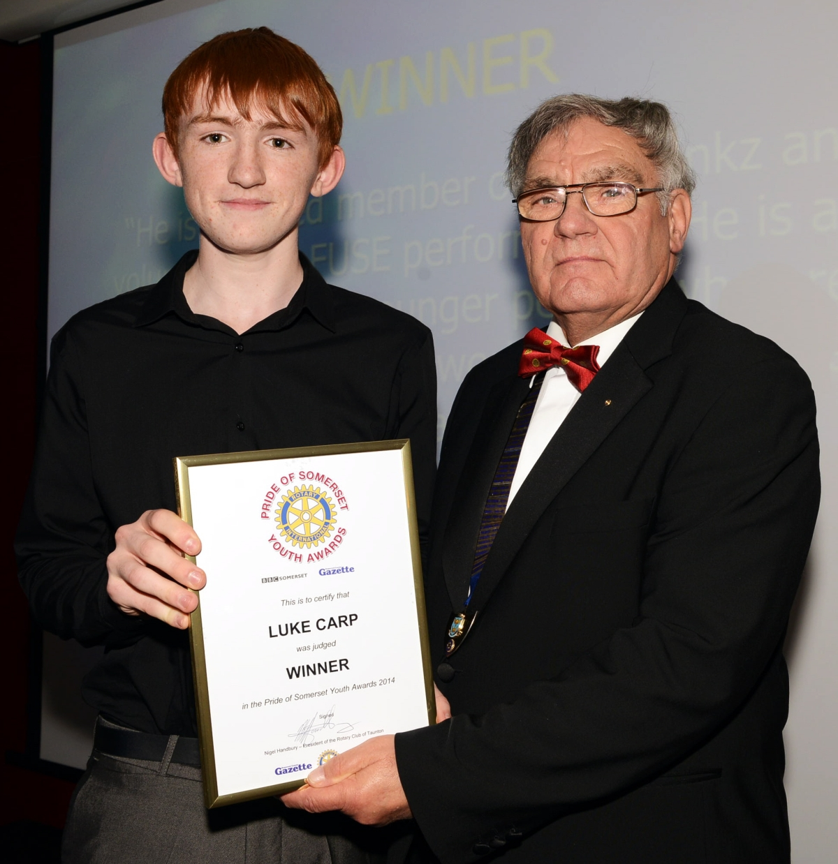 LUKE Carp receives his award from Rotary Club of Taunton president Nigel Handbury.