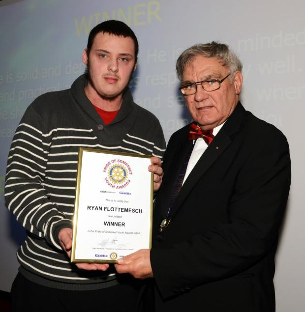 Yeovil Express: RYAN Flottemesch receives his award from Nigel Handbury, president of the Rotary Club of Taunton.