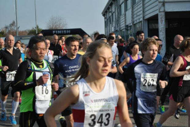 Yeovil Express: Paul Fraser, wearing the vest of Chard Road Runners, centre. Photo: Christine Jo