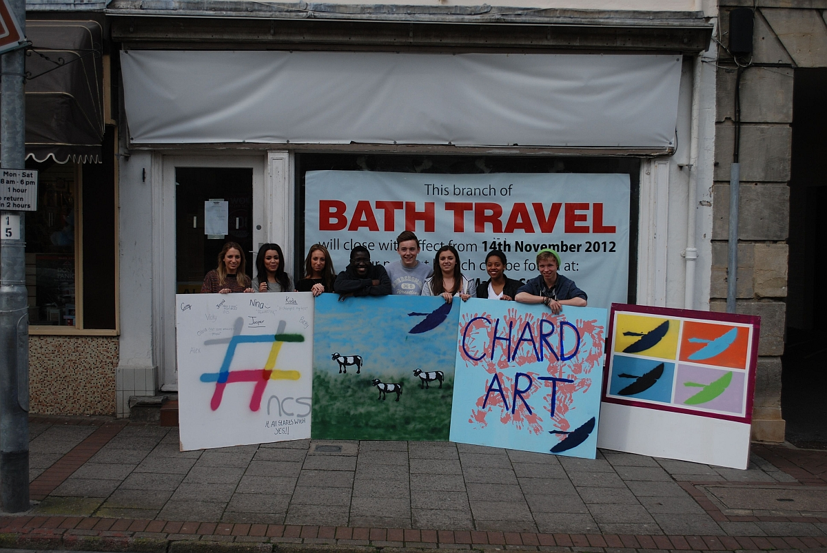 Students from Holyrood Academy with their boards outside the shop.