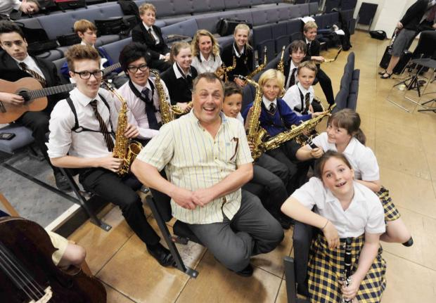 PETE Long pictured at a jazz workshop with students at Queen's College.