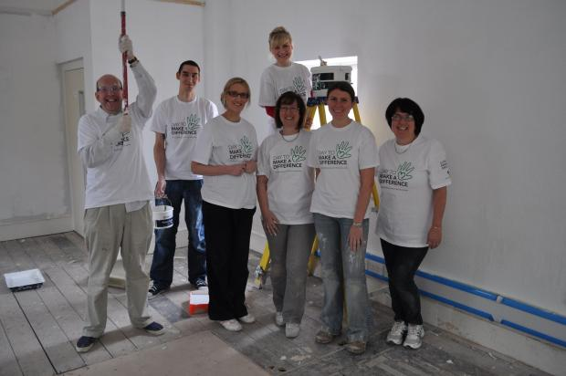 Yeovil Express: Lloyds Bank staff helping decorate the new premises.