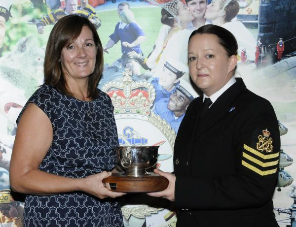 GILL Prouse hands the award to petty officer Michelle Evans from Ilchester. PHOTO: Dave Sherfield.