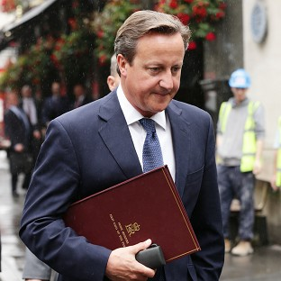Prime Minister David Cameron is urging Western nations to act in the face of Russia's actions in Ukraine