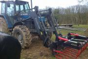 NEW Holland tractor and bale grab.