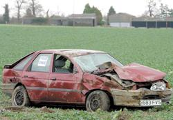 Yeovil Express: Wrecked - a car in a field beside the A120 between Wix and Ramsey. Picture: TERRY WEEDEN (53807-1)
