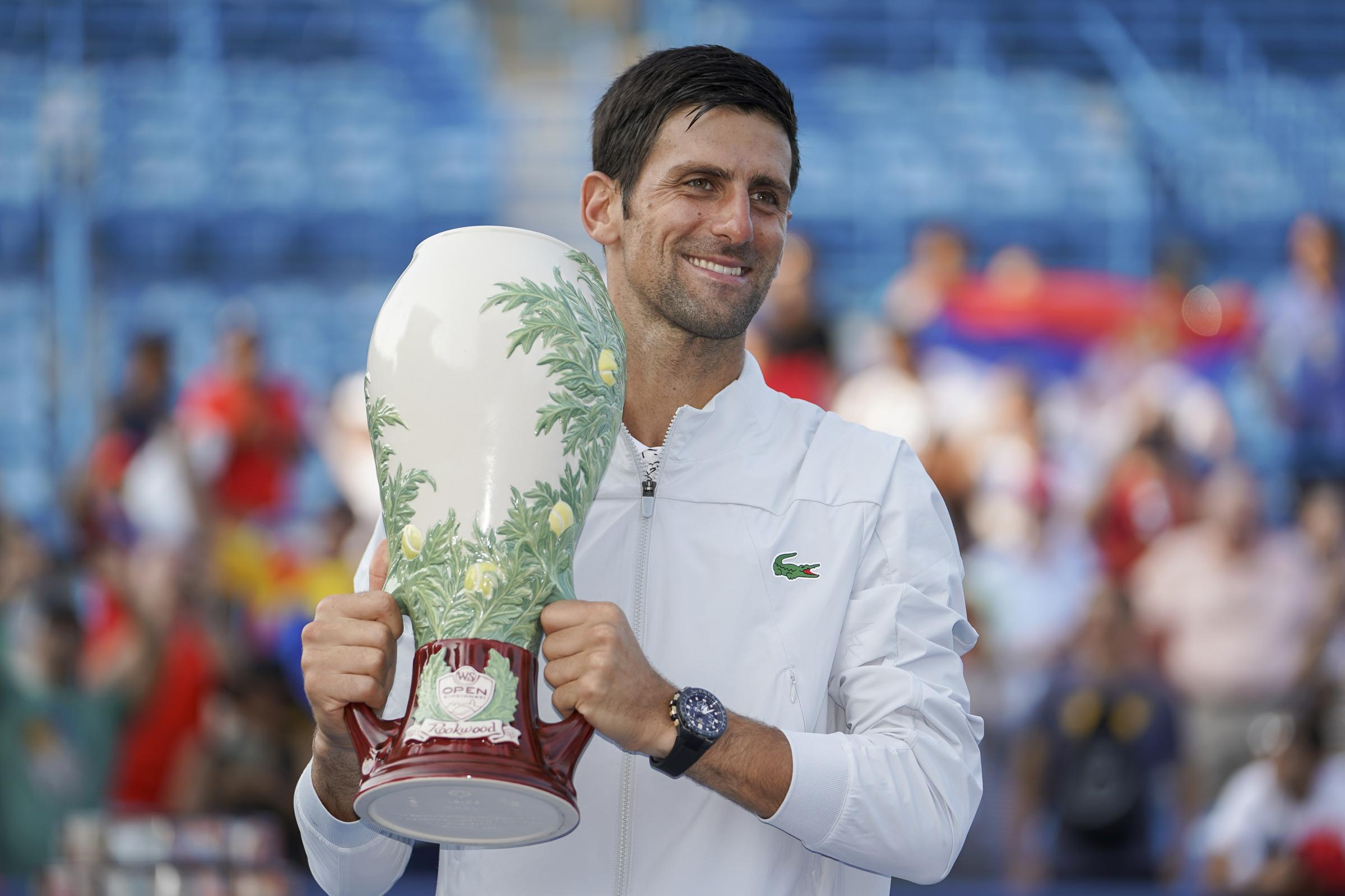 Novak Djokovic poses with the trophy