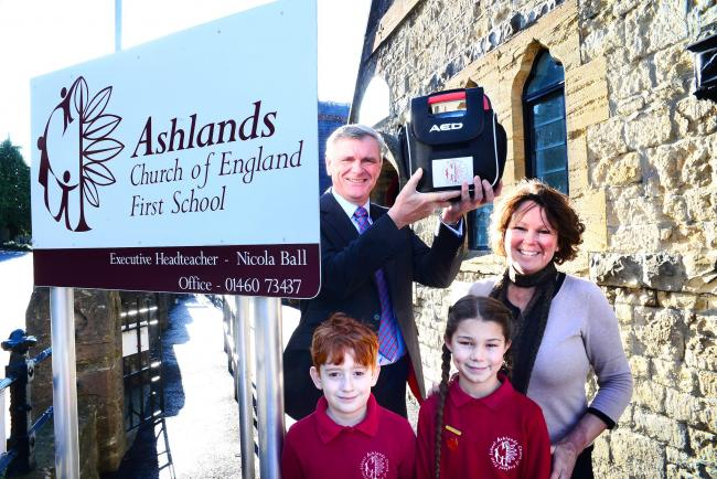 SUPPORT: Pupils Poppy and Billy with Ashlands First School's business manager Lisa Carter and Clive Wakely