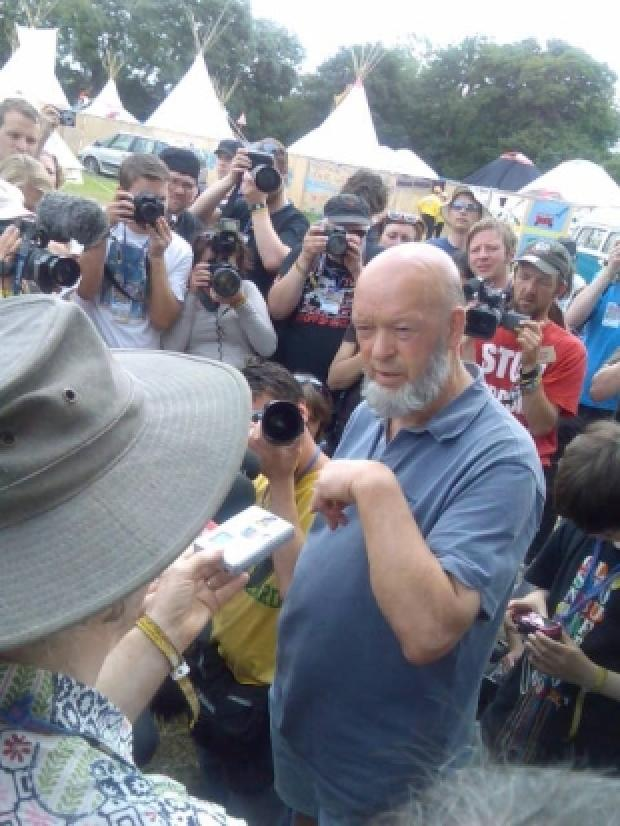 Michael Eavis amid the press