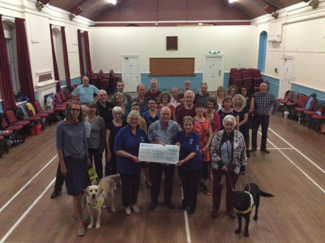 Sue Marks collects charity cheque for Guide Dogs