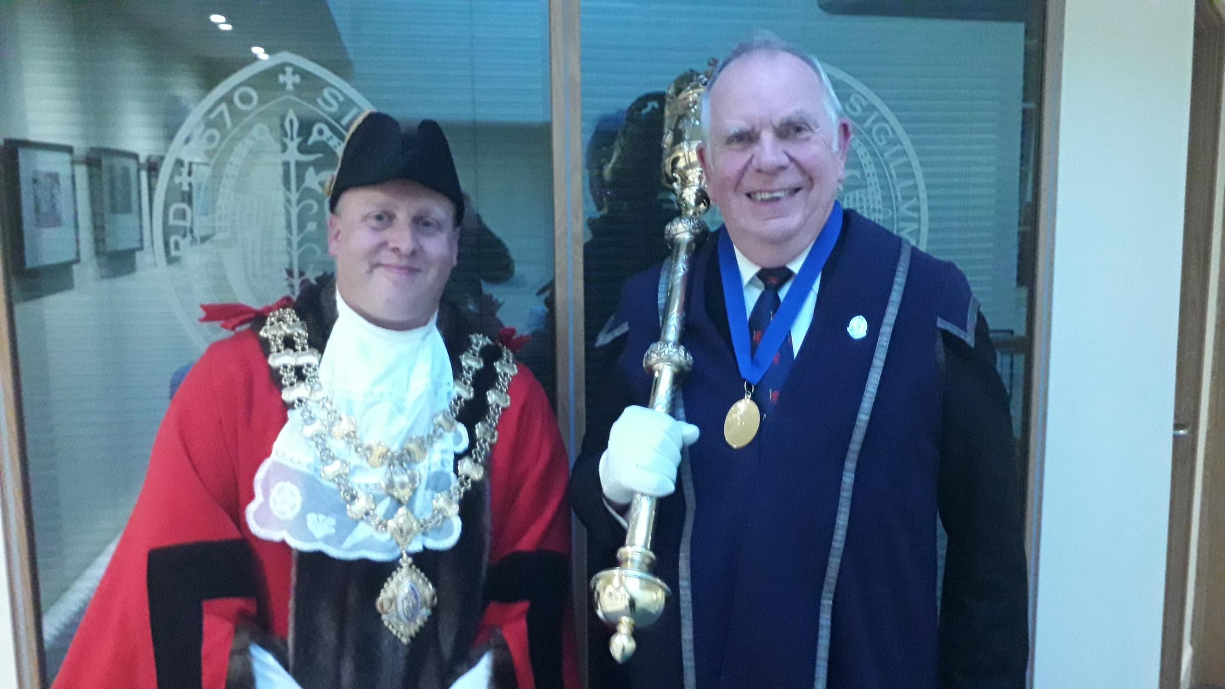 ELECTED: Cllr Jason Baker pictured in his official garb with Chard's macebearer Clive Sanders